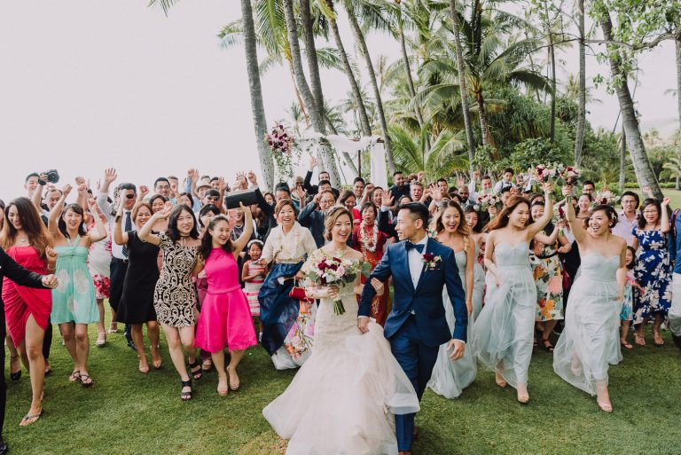 entire wedding guests and bridal party come charging happily to reception to celebrate