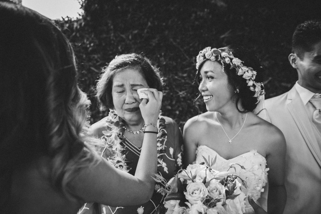 mother of bride crying with bride beside her black and white