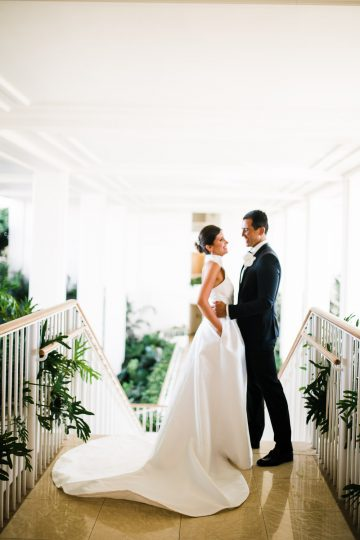 coupe stand atop staircase in wedding attire